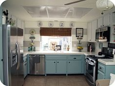 Affordable kitchen remodel, mostly done with paint. Love the horizontal stripes on the wall, and the white tile countertops.
