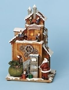 "Amazon.com: 11""h Musical Santa's Workshop Fig with B/o Revolving Light W/o Batteries. 11""h 7""w 5.75""d: Patio, Lawn & Garden"