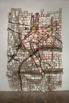 EL ANATSUI :: JACK SHAINMAN GALLERY art from discarded objects, such as the metal wrapping on wine bottles. El Anatsui, artist from Ghana, Africa.