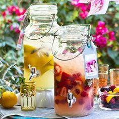 This grown-up lemonade stand, where the drinks are infused with herbs and studded with fresh fruit, looks as good as it tastes. Float lemons, herbs, or strawberries in the pitchers to add color to your outdoor table. Party Drinks, Fun Drinks, Beverages, Fruity Drinks, Cocktails, Refreshing Drinks, Summer Drinks, Sangria, Outdoor Table Centerpieces