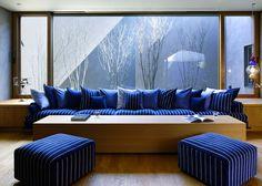 Hiroshi Nakamura creates warren-like car showroom and home