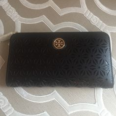 Tory Burch zip around wallet Cut out flower design Tory Burch zip Wallet. New with tag. Tory Burch Bags Wallets