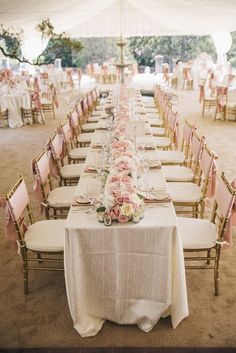 white and pink wedding table settings - I like that it's one long table! - beach wedding