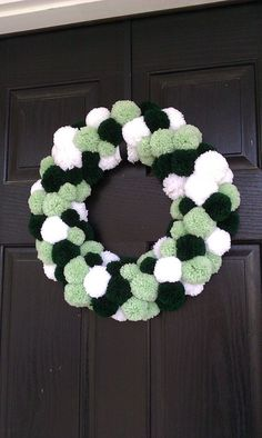 our March wreath...greens & white pom poms!