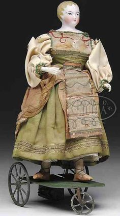 Vichy Tin-Automata Provincial maiden on wheeled base. This piece is u Miniature Bases, Rocking Horses, Tin Toys, Antique Toys, Antiquities, Just For Fun, Doll Houses, Doll Toys, Puppets