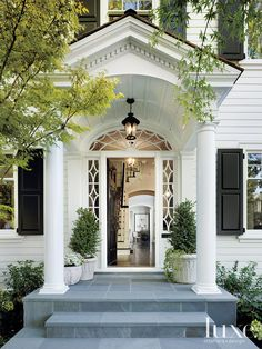 This Northern California home stays true to its 1920's Dutch colonial revival aesthetic. The greenery is limited in color to complement the home's architectural style and serene interior palette. Connecticut bluestone is laid in a random pattern at the foot of this entrance.