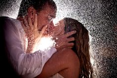 Couple passionately kissing in the rain, taken by South Africa wedding photographer, Yvette Gilbert