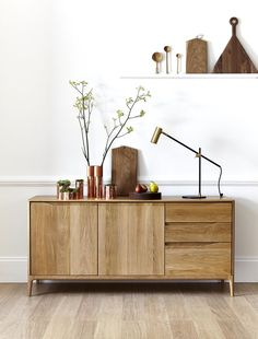 industrial sideboard styling with copper and wooden deco elements More