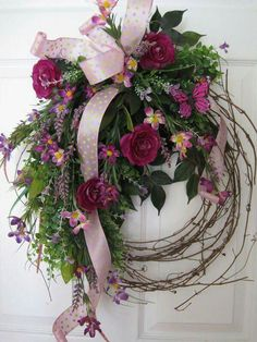 This is a beautiful wreath that can be used for several occasions,it has spring purple and pink flowers,(flowers will vary) it also has butterflies and a plaid purple bow, it is on a grapevine wreath to. Wreath Crafts, Diy Wreath, Door Wreaths, Grapevine Wreath, Wreath Ideas, Wreath Making, Diy Crafts, Easter Wreaths, Holiday Wreaths
