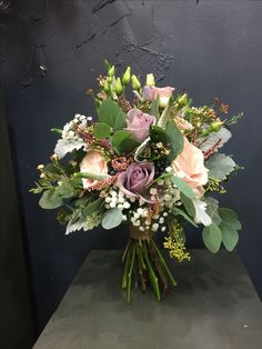 Stunning Bridal bouquet with Amnesia&Sweet Avalanche roses, white lisianthus, gypsophila, wax flowers, eucalyptus berries, viburnum berries, silver leaves.