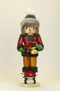 Girl Holding Poinsettia Plants German Wood Christmas Nutcracker Made in Germany