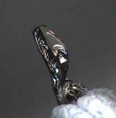 Sylvanite, (Au,Ag)2Te4, Cripple Creek District, Teller Co., Colorado, USA. Dimension crystal mm. 2,1. Copyright: © L.C. 2012