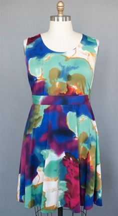 Cynara Dress - by Lucie Lu Plus size Lady like watercolor print dress. Zip up the back. Stretchy empire waist ties in back. Flouncy skirt. Darts at chest for a smooth fit.