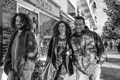Friends - A girl wearing a Metallica shirt and two men walking in the streets of Vence in the South of France looking cheerful. Street Pictures, Two Men, South Of France, Girls Wear, Metallica, Cheer, Walking, Friends, Shirt