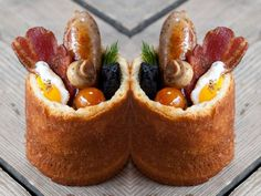 BunnyChow - A Soho restaurant that serves breakfast as a hollowed out brioche bun filled with mushrooms, bacon, spicy baked beans, sausages and black pudding has been named the UK's most innovative at the Best Breakfast Awards 2015.