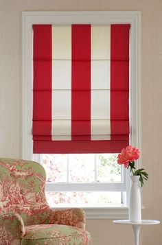 roman shades in striped fabric with banding on botton : knife pleat style