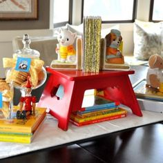 I like the idea of the vintage toys and books -maybe even use a little wagon with ABC blocks in place of stool