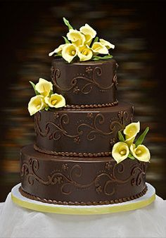 Chocolate wedding cake. (would be pretty with just about any other colors of flowers as well)