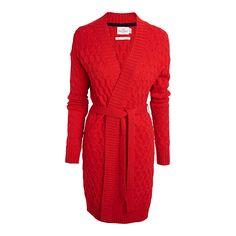 En längre cardigan som är mysig att svepa om sig. Med ull i den mjuka materialblandningen försäkrar vi dig om att den står emot kyligare temperaturer.