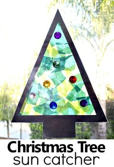 Christmas Craft for Kids-Easy christmas tree sun catcher. This Christmas tree sun catcher holiday craft is great for artists of all sizes. Sort and count jewels, rip tissue paper, and create beautiful holiday art! Preschool Christmas, Christmas Tree Themes, Christmas Crafts For Kids, Christmas Activities, Simple Christmas, Holiday Crafts, Christmas Holidays, Spring Crafts, Celebrating Christmas