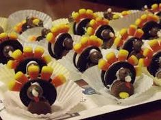 a oreo cookie turkey with candy corn- so cute!
