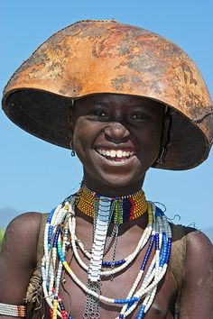 Africa |  Portrait of a smiling Erbore girl. Omo valley, Ethiopia | © Johan Gerrits