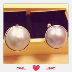 A pair of genuine mabe pearl cufflinks in 925 silver.  Priced at $398.