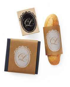 Commission a custom rubber stamp bearing your monogram using this design, then apply it to kraft paper and wrap around mini baguettes for hearty food favors.