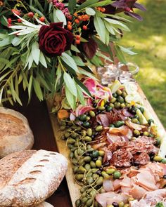 Pinterest Board: Wedding Reception  A 10-foot spread of almonds, dates, olives, cheeses (truffled Brie and local chèvre), and the charcuterie cured by the bride's father added up to one superb predinner display.