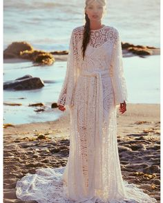 Completely ethereal and goddess-like, the style's intricately embroidered sheer mesh lace, flowing hemline, and dramatic dolman sleeves ad...