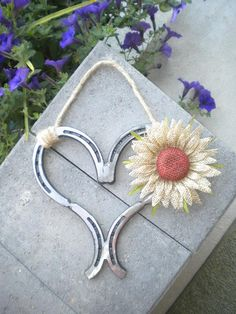 Decorated heart horse shoe hanger....they make excellent gifts for a western style wedding or great in a cabin or country setting....decorated they are $30 plus shipping from Idaho (83221)