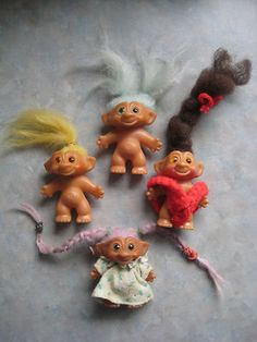 Back in the 60's, we didn't call them trolls, they were just wishniks. The small ones we got from gumball machines. Custom was to rub the belly and make a wish! :) Of course then the hair styling would begin!