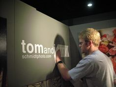 Place your biz name/logo using vinyl (or contact paper) directly to your booth wall.