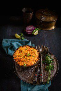 Baingan Ka Bharta or smoked eggplant mash is a popular Indian dish made by roasting the eggplant on direct heat and then mixing it in a masala.