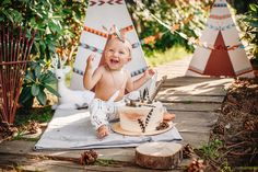 Very first birthday cakesmash for little redskin Indian injun boy! Wigwam and feather in a cake! Decor and decorations outdoor