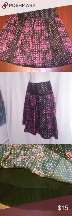 "High waist Flower skirt Silky soft polka dotted skirt with pink flower pattern. Perfect for summer!! Zippered side and a slight ruffled lining. Never worn! Length is 23""  waist is 30"" around. Hips are 37"" shell is 100% polyester lining is 100% nylon. limited too Skirts"