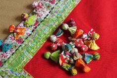 Fabric Pom Pom Tutorial -- Pom Poms!!! by maureencracknell, via Flickr