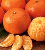 10 Good Luck Foods for the Chinese New Year, including tangerines and oranges, which when displayed and eaten, are said to bring wealth and luck.
