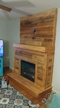 Made out of 2x4s and pallet wood. Minis the gireplace insert this cost me under 100 bucks.