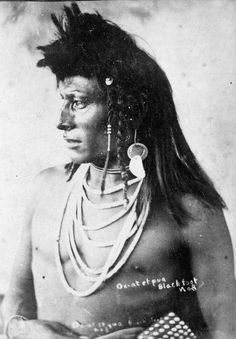 "Blackfoot man, late 1880s by Russell, Lethbridge. Galt Museum. [Identified in the photo as ""Ox-at et pua"". JE]"