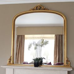 "First choice for space over a fireplace - a large mirror to bounce light and enlarge the room. Last choice - the ""black hole"", other wise known as the wall mount flat screen TV. Mirror Above Fireplace, White Fireplace, Fireplace Screens, Fireplace Mantle, Wall Mirror, 1930s Fireplace, Mirror Shop, Design Websites, Living Room Mirrors"