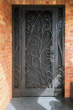 A unique wrought iron security entry door by Adoore Iron Designs located in Melbourne Australia. Wrought Iron Security Doors, Security Gates, Wrought Iron Doors, Security Screen, Wrought Iron Gate Designs, Wrought Iron Wall Decor, Double Screen Doors, House Front Door, Front Porch