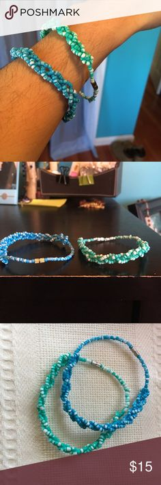 Beaded Bracelets from Mexico Beaded bracelets with a clasp. Can be difficult to try and put on by yourself. Paint peels away easily and has already done so. The white is the paint peeled away and the original colors are the green and blue. Jewelry Bracelets