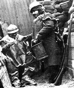 WW1. Distribution of wine, French trench.