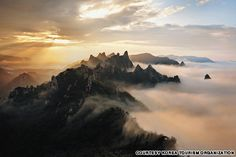 """Gongryong Ridge, Seorak Mountain (설악산 신선대 공룡능선) Thought to be shaped like the spine of a dinosaur (hence the name, """"Dinosaur Ridge""""), this rocky ridge offers spectacular views of both inner and outer Seorak. The climb is no picnic: the peak elevation of Gongryong Ridge, the most popular ridge route in the range, is approximately 1,200 meters. (http://travel.cnn.com/seoul/visit/50-beautiful-places-visit-korea-873093)"""