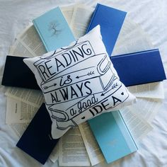 books + pillow by readsleepfangirl