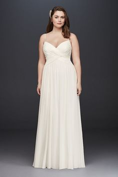 9f3e75e3d1f0 A sweet and simple wedding dress, perfect for a beach ceremony or garden  soiree.
