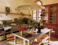 french country style kitchen with a stone floor
