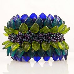 Beautiful bracelet - seed beads and Czech pressed leaves in blue, green, and purple.