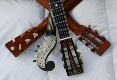 The Gibson Company Guitar and Mandolin